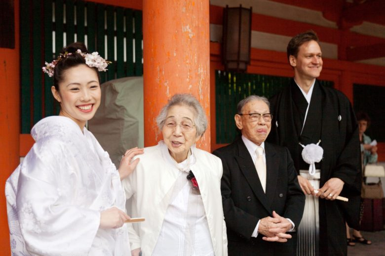 Bride and groom in Japanese wedding outfits, with older relatives